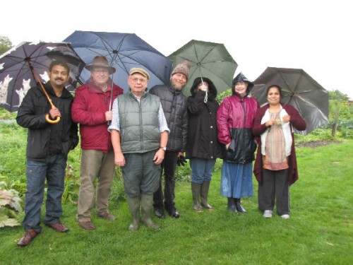 Umbrellas up and wellies on ready for the allotment tour